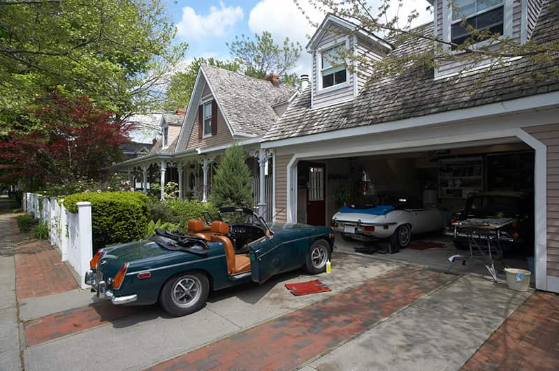 Car in driveway garage door up garage door repair service - Garage Harmony
