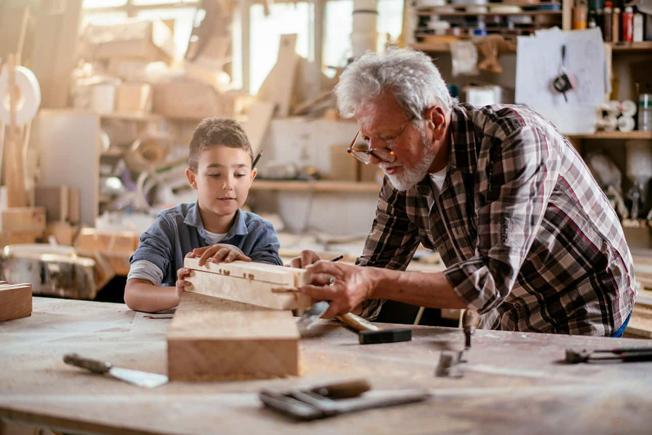 Grandson and Grandfather in a garage woodshop - Garage Harmony