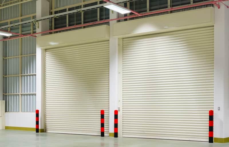Installation of two warehouse overhead garage doors Garage Harmony